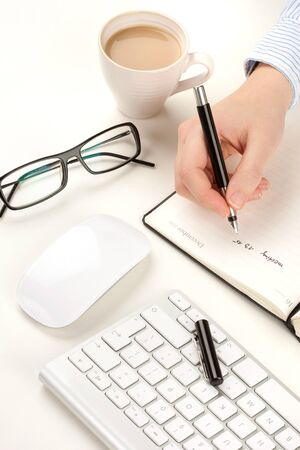 Businessman desk with hand and pen Stock Photo - 13606341