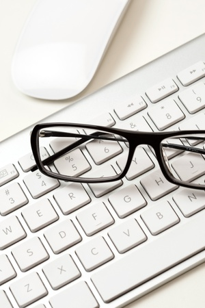 Glasses and keyboard Stock Photo - 13606339