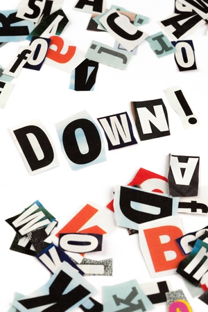Down inscription made with cut out letters Stock Photo - 13691694