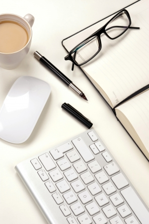 Businessman desk with notebook, glasses, pen, mouse and keyboard Stock Photo - 13724355