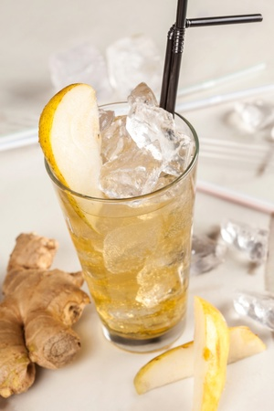 Yellow drink with pears, ginger and ice photo