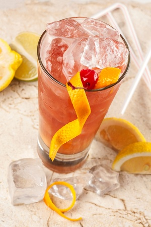 Refreshing red drink with grapefruit, lemon and ice Stock Photo