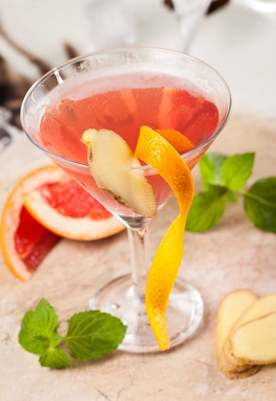Red drink with grapefruit and ginger  photo