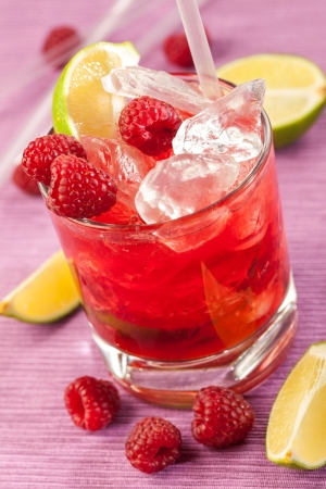 Red drink with raspberries and ice
