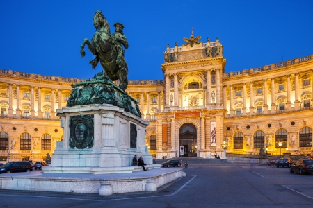 habsburg: Vienna, Austria - August 30, 2013; Hofburg Palace  Was home for the most powerful people in European and Austrian  Habsburg dynasty   Neue Burg section on the photo with eqestrian statue of Emperor Joseph II  Evening view with illuminated building