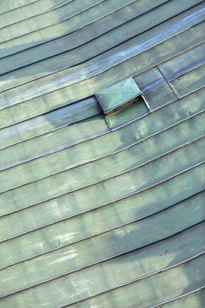 copper coated: Detail of the roof top covered by copper sheet coated with a patina