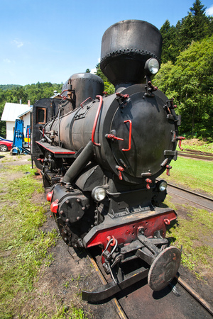 Narrow-gauge railway, steam train in Cisna, Poland photo