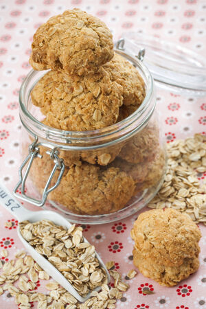 Oatmeal cookies in glass jar Stock Photo