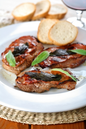 romana: Saltimbocca alla romana - Roast meat with wine Stock Photo