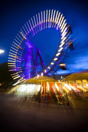 Abstract long exposure picture of oldest, historic ferris wheel in Prater Amusement Park in Vienna