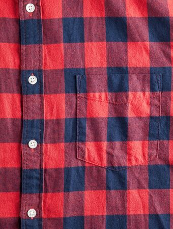 flannel: Texture of checkered flannel shirt with buttons and pocket Stock Photo