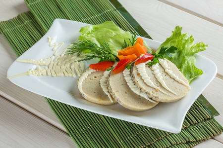 stuffed fish: Stuffed pike fish - sliced on white plate with parshley, salad, carrot Stock Photo