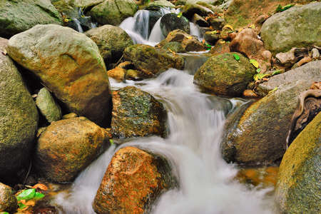 resound:  Water fall and rock and mountain foliage Stock Photo