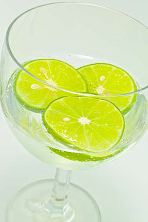 Lemon slice in glass wine with soda close up photo