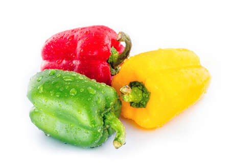 Red, Green and Yellow Bell Peppers with Drops of water photo