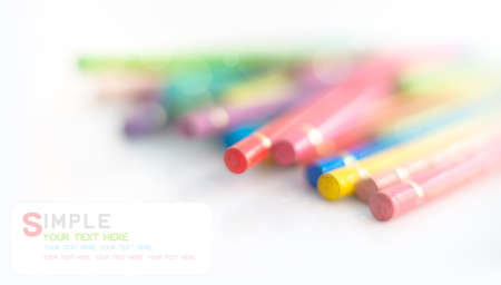 co lour: Smooth colored pencils and soft bokeh on white background with space text Stock Photo