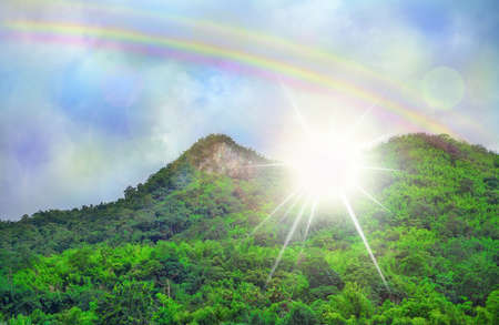 nifty: Beautiful sky cloud rainbow , green mountains dramatic light Stock Photo