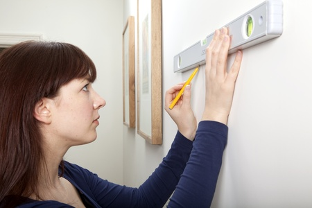 Woman Spirit level DIY Stock Photo - 9056117