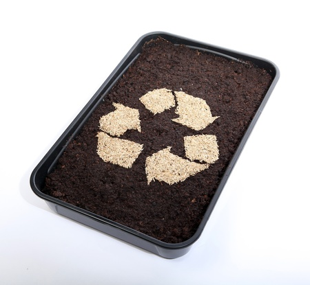 Recycle soil and grass seed Stock Photo