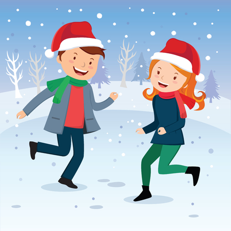 blissful: Winter fun. Dancing in the snow. Happy young couple or friends playing in the snow.