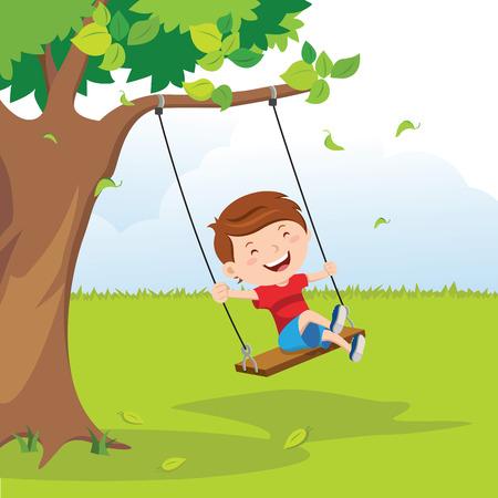 Little boy on swing under the tree