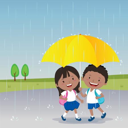 Children under the umbrella in the rainy day.