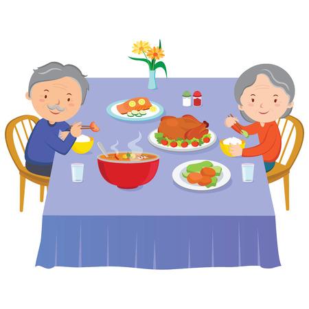 Elderly couple eating dinner