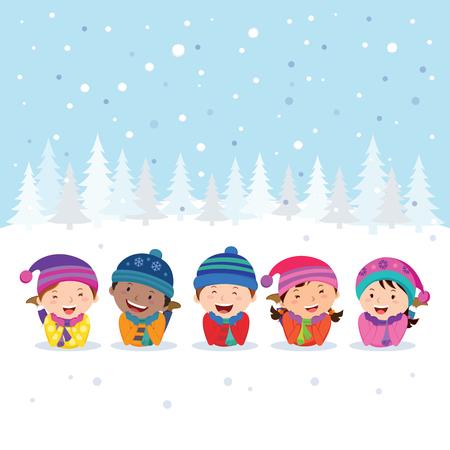 Winter fun. Cheerful kids lying on the snow.