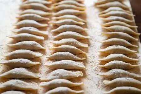 Hand Made Pasta Ravioli on a wood table Stock fotó