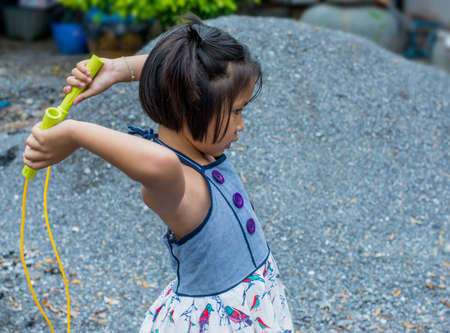 rope: A young girl enjoying her skipping rope Stock Photo