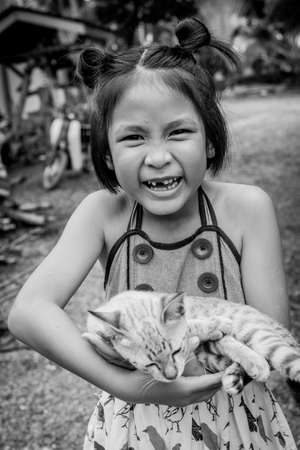 animal beautiful: smiley kid with a little cat