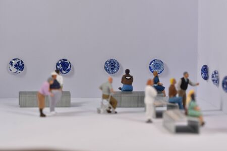 mini people in a museum