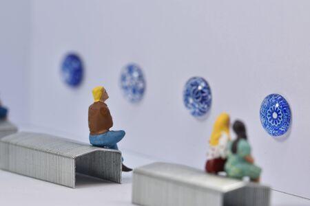 little people in an art gallery