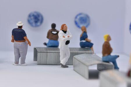 miniature people in an art gallery