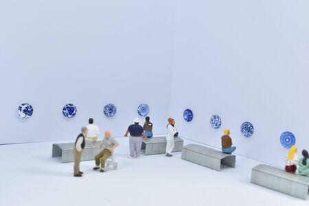 miniature figures visit a museum