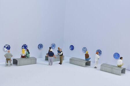 miniature people visit a museum