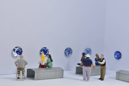 ministue people visit a museum