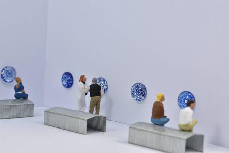 miniature people vist a museum Stock Photo