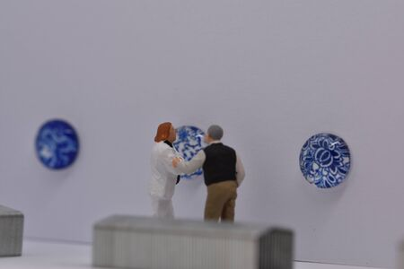 miniature people visiting a museum
