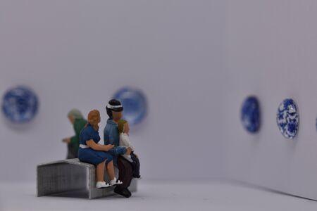 miniature people in an art gallery museum