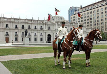 palacio: Presidential guards on horses at the parade grounds of Palacio de La Moneda Santiago Chile.