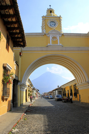 An arch with a clock in the city of Antigua Guatemala