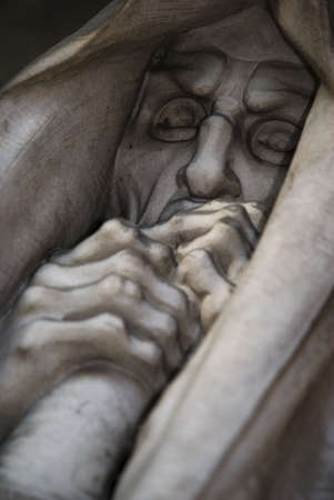 demented: mortal statue from a graveyard