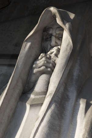 mortal statue from a graveyard closeup photo