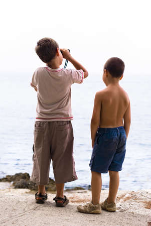 two boys with binoculars Standard-Bild