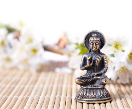 isolated buddah with flowers