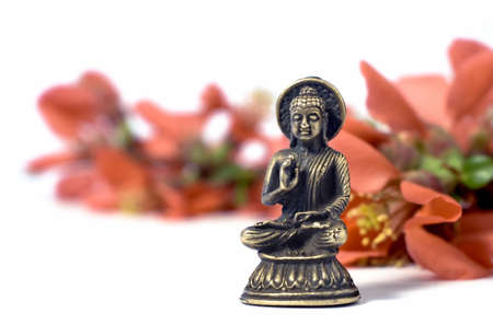 isolated buddah with red flowers