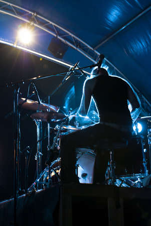drummer: drummers silhouette from the backstage
