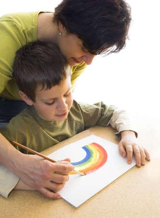 woman teach boy how to paint
