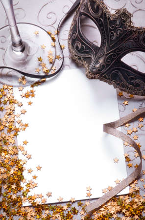 masquerade masks: party still life with blank paper for your text, vertical version Stock Photo